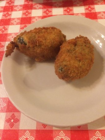 Weatherford, TX: Armadillo Eggs at the Mesquite Pit. Jalapeno peppers, fried, stuffed with brisket and cheese.