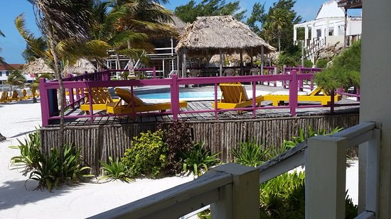 Exotic Caye Beach Resort: Pool is 4' x 14' - Bathtub shape. Deck is falling apart.