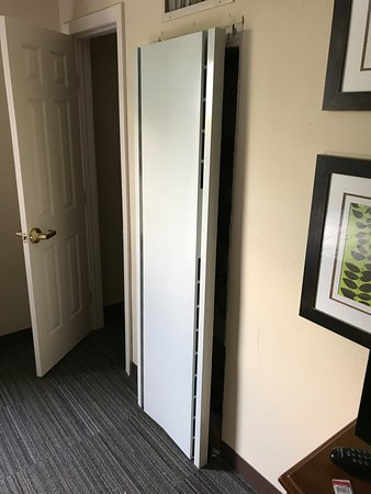 Billerica, MA: the 50+ pound door that fell off. This was fixed with regular screws on a drop wall. How terribl