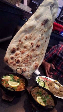 Family Naan with Seafood Curry and Lamb Curry