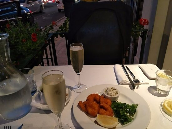 The Grill at 424 : Delicious, fruity prosecco with our tasty starter of breaded tiger prawns