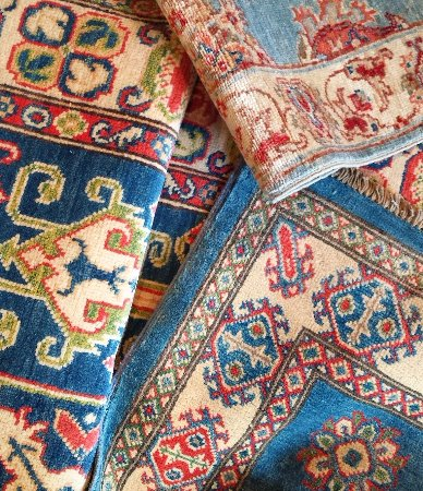 Washington, VA: Piles of blues...large selection and unique mix of new and antique rugs at r.h. ballard.