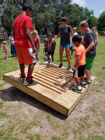 Brooksville, FL: Work together to solve this maze puzzle by moving the platform