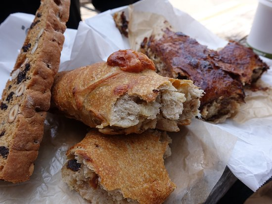 Freestone, CA: (From L to R) Chocolate Chip Hazelnut Biscotti - Fresh out of the oven Fougasse & Sticky Bun
