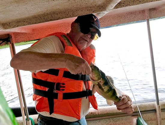 Gatun Explorer Panama Canal Jungle Day Tour : The fish really put up a sporting fight! It was work reeling them in.