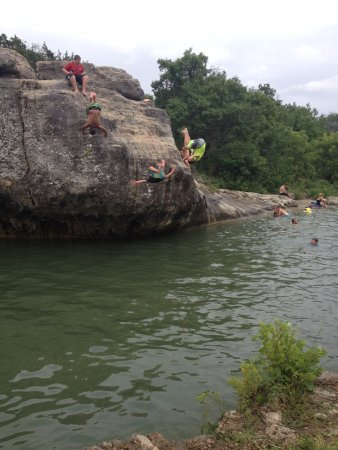 Crawford, TX: Teens Cliff diving at Tonkawa Falls Park