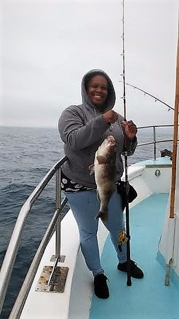 Dana Point, CA: My daughter lands this beautiful sandbass while targeting rockfish