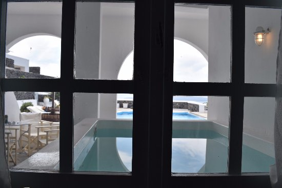 """Hotel Atlantida Villas: View looking out the living room window. right in front of """"Ares"""" apartment, a Jacuzzi, and you"""