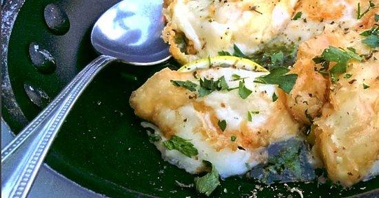 Dias Zeus: Kefalograviera Saganaki. Lightly spiced and delicately fried Greek cheese with lemon.