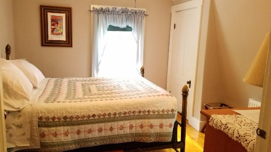 """Chocorua, NH: Room with antique brass bed, (double) Mattress with """"Cool Action Gel Memory Foam""""."""