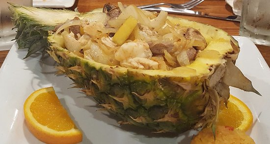 Bryan, OH: Chicken, steak, shrimp, onion, and mushrooms, served in a pineapple.
