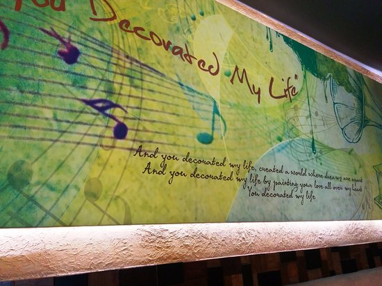 Inside The Restaurant A Wall Decorated With Lyrics