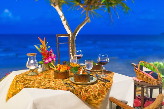 Dining overlooking the beach at Poppies Restaurant