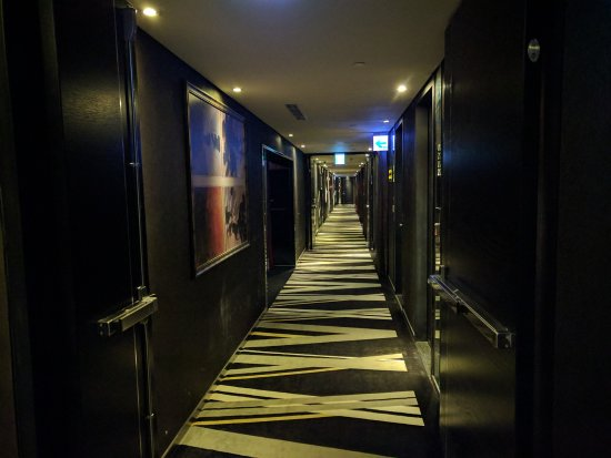 FX Hotel - Taipei Nanjing East Road: Hallway. Looks dark because of the black colored theme.