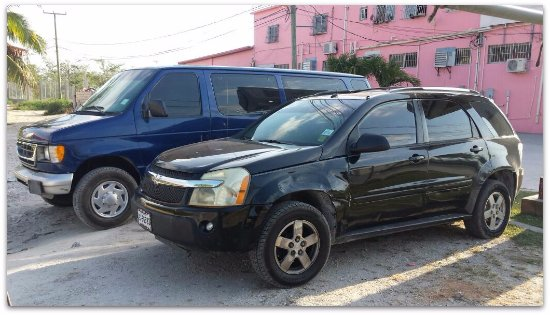 Ladyville, Belize: Two of the vehicles we use to get our customers where they need to go, safely and comfortably.