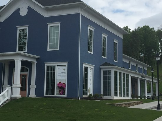 Victor, NY: RELAX is the blue building across from Eastview Mall