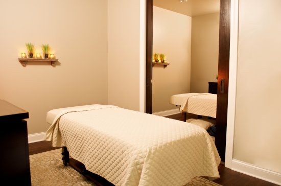 Victor, NY: Peaceful massage rooms with a pocket door for couples massage experience