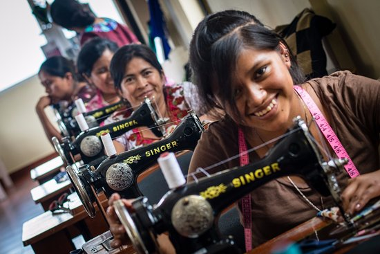 Santa Cruz La Laguna, Guatemala: Local artisan sewing products in our workshop