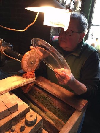 Randy Kirkendall cutting glass in the back room at Warsaw Cut Glass.  Ask for a demonstration!