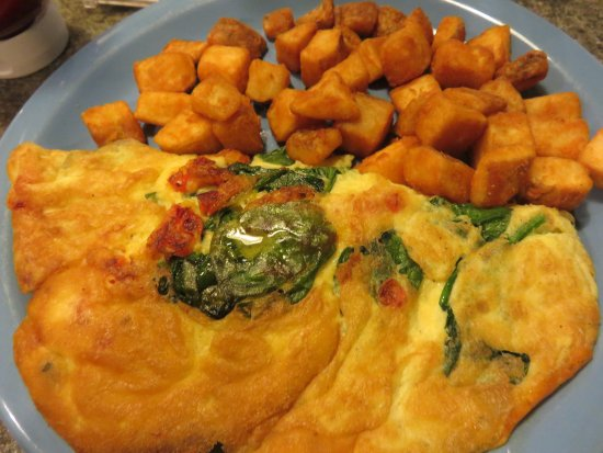 Painted Post, NY: Spinach, tomato and cheddar omelet with fries.