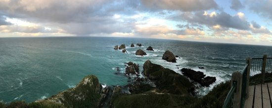 Nugget Point: A panaramic shot of the sea and rock behind the light house