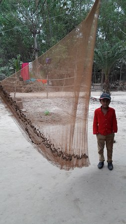 Barddhaman, India: My Nephew near the fishing net of a villagers house of Orgram forest