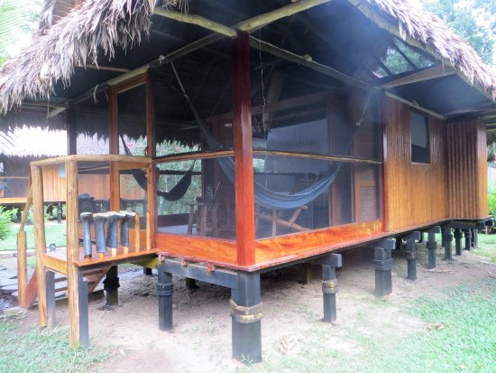 Inkaterra Reserva Amazonica: Looking at your cabin, hammocks are great to relax in and there's space for your wellies to dry!