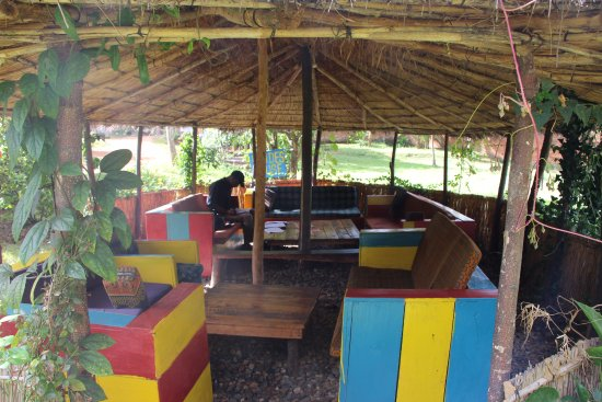 Pakachere Backpackers: One of the summer huts in our big garden