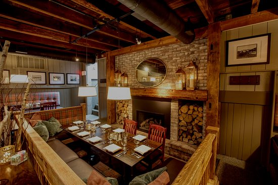 Harrison's Restaurant & Bar: seating area for up to 10 guests by the fireplace