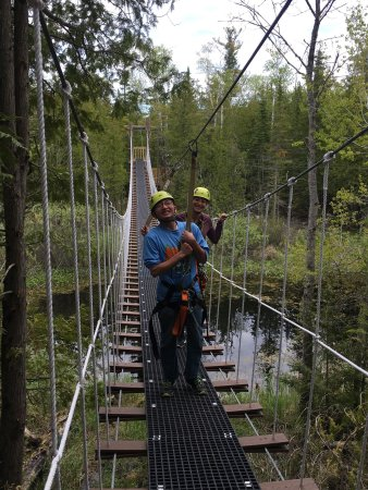 Baileys Harbor, Висконсин: Enjoying beautiful summer days out here on the Zipline! Come on out and try our Race Zip and new