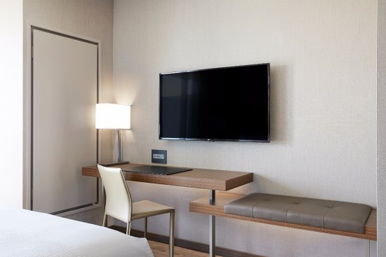 Each of our stylish guest rooms come with a 49 smart tv for Stylish hotel rooms