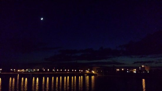 Rock Falls, IL: Balcony view of river with moon in background