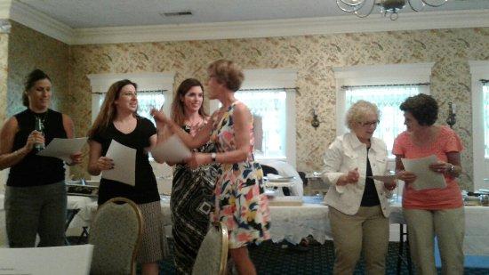 Bristol, CT: Several ladies celebrating at a Teacher Retirement party
