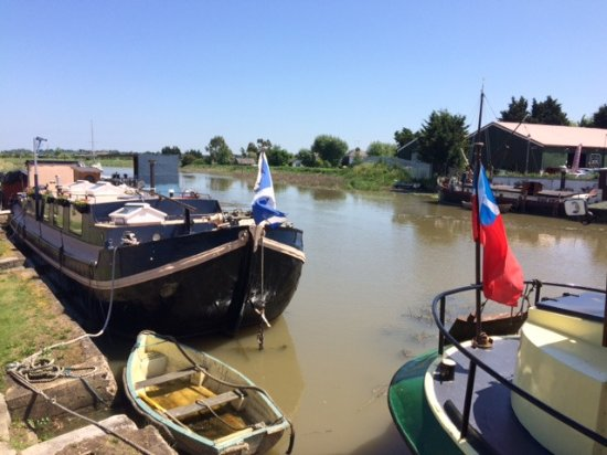 Battlesbridge, UK: River Crouch Barges next to The Barge.