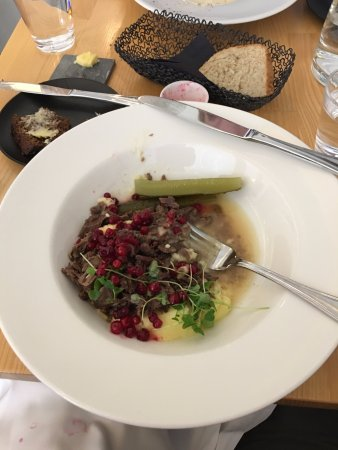 Sautéed reindeer on mashed potatoes with lingonberries