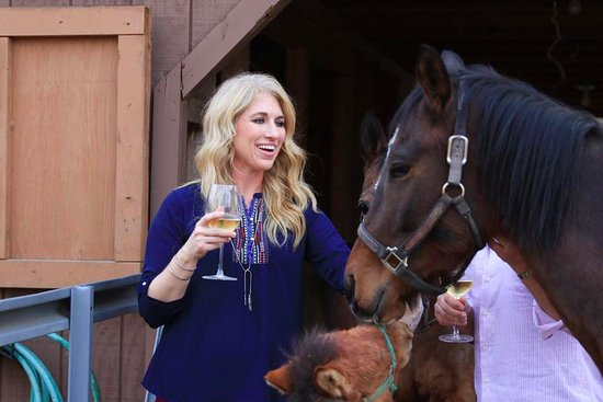 Chelsea, AL: Robyn Lyons, co-owner, with Prince, a Thoroughbred  and Pedro, the mini-donkey