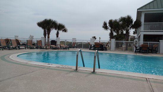 pool area on a very breezy day picture of islander inn. Black Bedroom Furniture Sets. Home Design Ideas