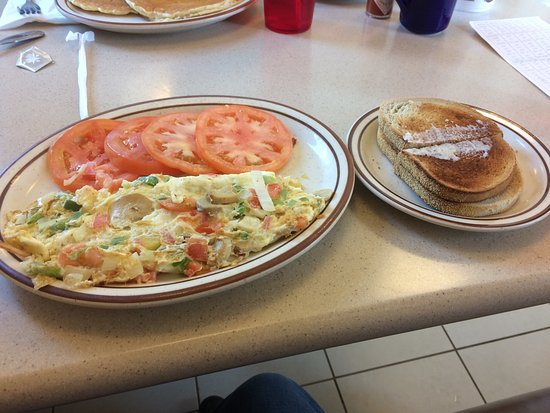 Lake Orion, MI: Veggie omelette with tomato slices sunny side up eggs and pancakes