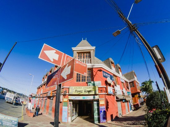Pichilemu, Chile: Our school is located on the third floor of this red building. Corner of Ortuzar and Anibal Pint