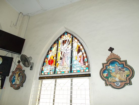 "St. Francis Xavier Church: A Crucifixion-scene plate on each side of a ""beautiful window"""