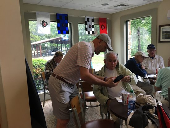 Burkesville, KY: A group of guys who are retired pilots and a couple enjoying a day golfing.
