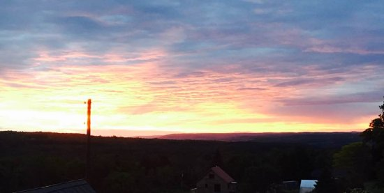 Newfield, NY: Sunrise from our room at Enfield Manor. Ithaca College on hillside six miles away as the crow fl