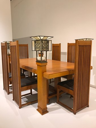 Smart Museum of Art: Dining suite by Frank Lloyd Wright creates intimacy as diners are hidden by chair backs + lamp p