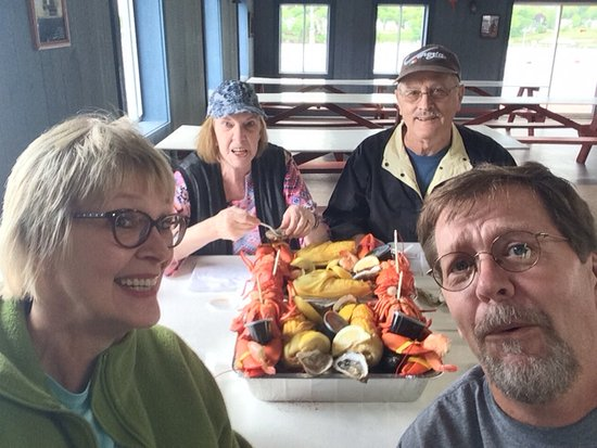 Happy travelers ready to consume a fabulous meal in Belfast, Maine!