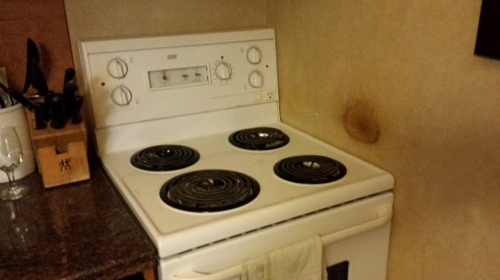 Hidden Ridge Resort: Stove missing knobs on timers and note burn on wall.