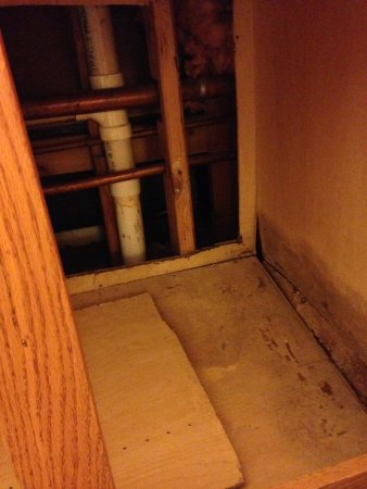 MainStay Suites : Mold under bathroom sink. Wall removed and seeing into the adjoining bathroom.