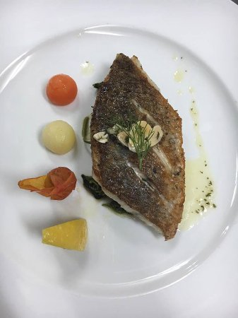 Saint Ouen, France: Grilled Filet of Sea Bass (Pla Kraphong) served with Butter Sauce le Coq d'Or Restaurant