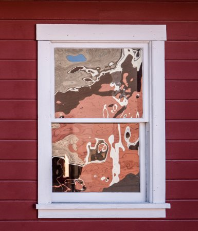 McCarthy, AK: Abstract reflections of mountain sky and red mill at Kennecott