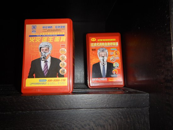 Danzhou, China: Ontsnappingsmaskers voor bij brand