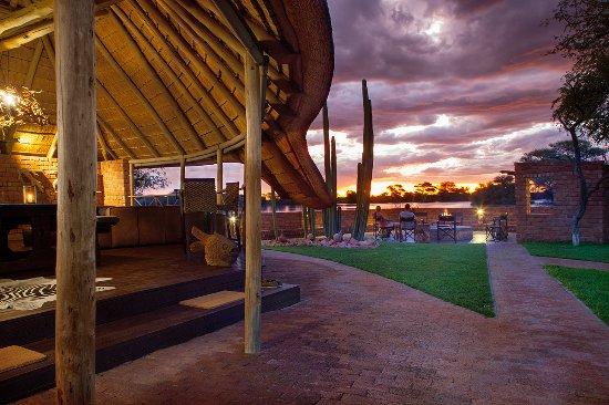 Okahandja, Namibia: Sundowner around the fire place with view of seasonal farm dam